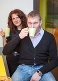 Young couple drinking tea during break Royalty Free Stock Photo