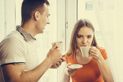 Young couple drinking tea or coffee at home Royalty Free Stock Photography