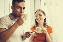 Young couple drinking tea or coffee at home Stock Photo