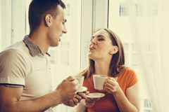 Young couple drinking tea or coffee at home Royalty Free Stock Image