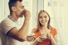 Young couple drinking tea or coffee at home Stock Images