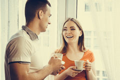 Young couple drinking tea or coffee at home Stock Photography