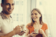 Young couple drinking tea or coffee at home Stock Photos