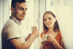Young couple drinking tea or coffee at home Royalty Free Stock Images