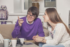 Young couple drinking tea in the discussion of ideas Royalty Free Stock Photo
