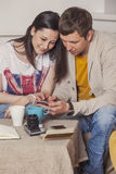 Young couple drinking tea in the discussion of ideas Stock Photography