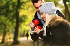 Young couple drinking tea outdoors Royalty Free Stock Photo