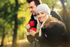 Young couple drinking tea outdoors Royalty Free Stock Photography
