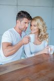 Young couple drinking their morning coffee Royalty Free Stock Image