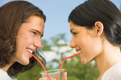 Young couple drinking together Stock Image