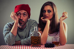 Young couple drinking whiskey Royalty Free Stock Photos