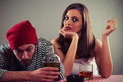 Young couple drinking whiskey Royalty Free Stock Photography