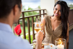 Young couple drinking wine ad toasting royalty free stock images