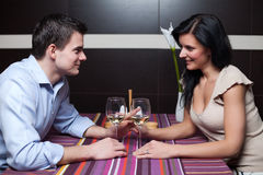 Young couple drinking wine and flirting Royalty Free Stock Photography
