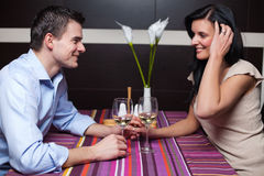 Young couple drinking wine and flirting Stock Image