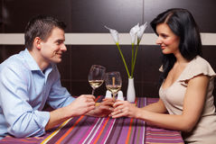 Young couple drinking wine and flirting. Attractive young couple drinking wine and flirting Royalty Free Stock Photo