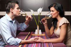 Young couple drinking wine and flirting Stock Photography