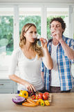 Young couple drinking wine in kitchen Stock Images