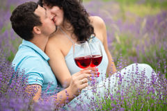 Young couple drinking wine. In lavender field Stock Photo