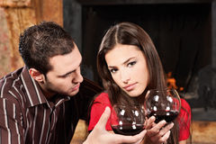 Couple drinking wine near fireplace Stock Photography