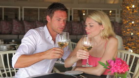 Young Couple Drinking Wine In Restaurant Royalty Free Stock Image