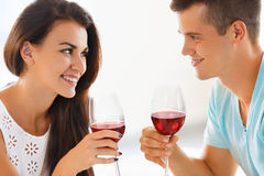 Young couple drinking wine. Romantic relationship. Stock Images