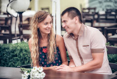 Young couple with drinks in cafe outdoor Royalty Free Stock Photo