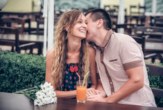Young couple with drinks in cafe outdoor Stock Photos