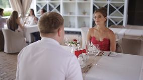 A young couple communicating in a summer restaurant stock footage