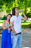 Young couple drinks water Stock Images