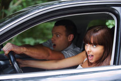Young couple driving car royalty free stock images