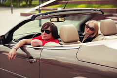 Young couple driving a convertible car Royalty Free Stock Images