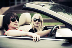 Young couple driving a convertible car Stock Photography