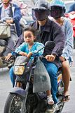 A young couple driving on a motorbike in Bangkok traffic royalty free stock photography