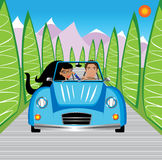 Young couple driving in mountains Stock Images