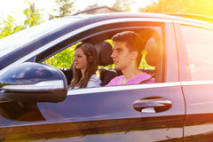 Young couple driving in a new car Stock Image