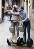 Young couple driving segways Royalty Free Stock Photography