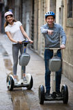 Young couple driving segways Stock Photo