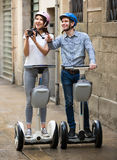 Young couple driving segways Stock Photography