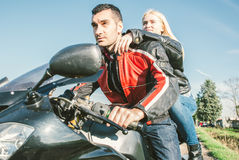 Young couple driving on a sport motorcycle Royalty Free Stock Photo