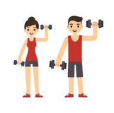 Young couple with dumbbells Stock Photos