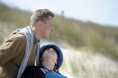 Young couple in the dunes Stock Photos