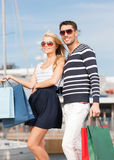 Young couple in duty free shop Royalty Free Stock Images