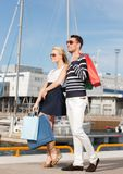 Young couple in duty free shopping bags Stock Image