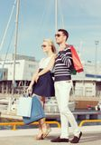 Young couple in duty free shopping bags Royalty Free Stock Photo