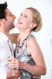 Young couple in each others arms Stock Images