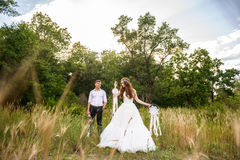 Young couple in the ears of wheat in forest Royalty Free Stock Images