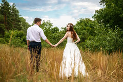 Young couple in the ears of wheat in forest Royalty Free Stock Photos