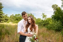 Young couple in the ears of wheat in forest Royalty Free Stock Photography