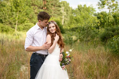 Young couple in the ears of wheat in forest Stock Photo